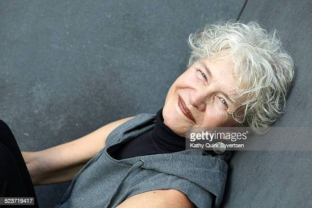 Portrait of happy 65 year old senior woman