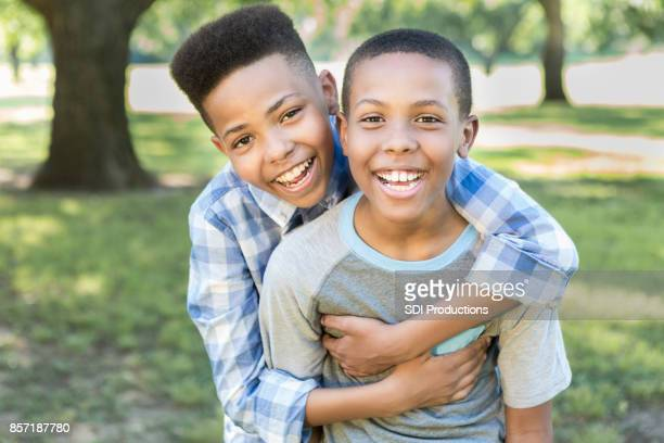 portrait of happy african american brothers - handsome black boy stock photos and pictures