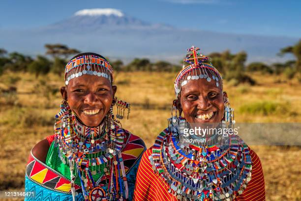 portrait of happy african women, mount kilimanjaro on the background, kenya, east africa - east african tribe stock pictures, royalty-free photos & images