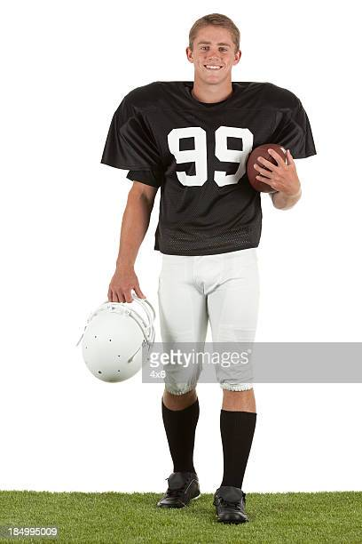 portrait of happy american football player - american football strip stock pictures, royalty-free photos & images