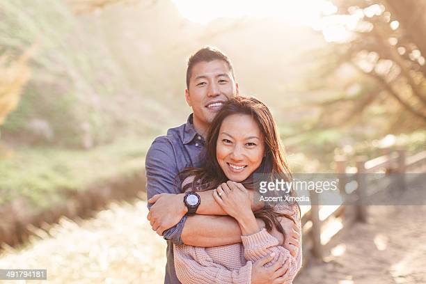 Portrait of happy Asian couple in forest setting