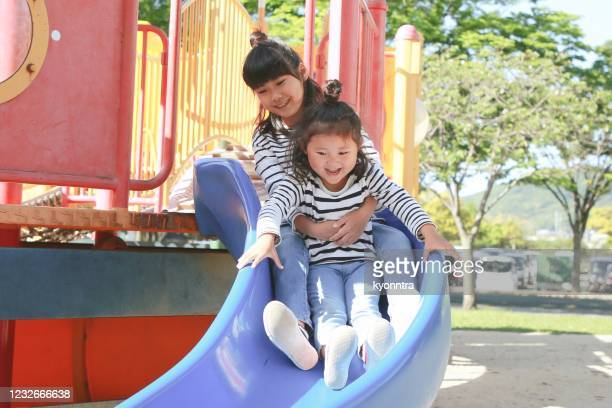 portrait of happy asian girls playing - kyonntra stock pictures, royalty-free photos & images