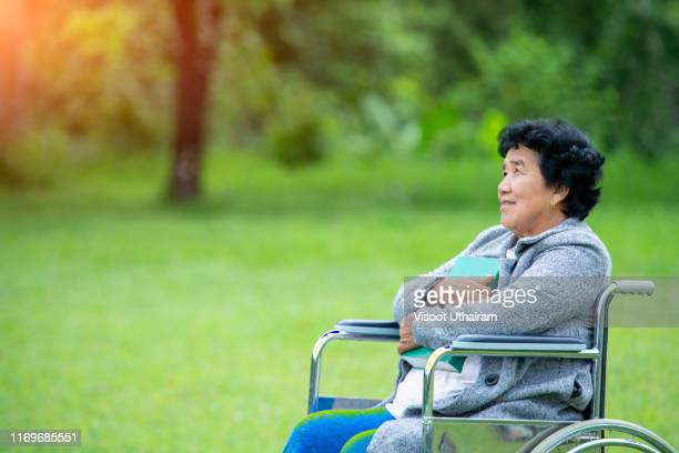 portrait of happy asian old woman sit on wheelchair. - 1985 stock pictures, royalty-free photos & images
