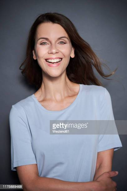 portrait of happy attractive woman - mid adult stock pictures, royalty-free photos & images