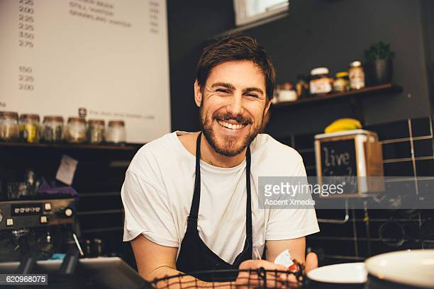 portrait of happy barrista at espresso bar - wait staff stock pictures, royalty-free photos & images