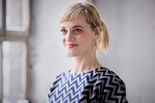 Portrait of happy blond businesswoman - gettyimageskorea