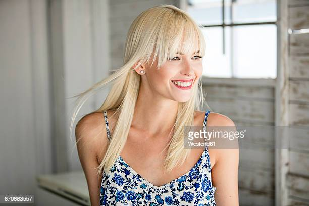 Portrait of happy blond woman in summer