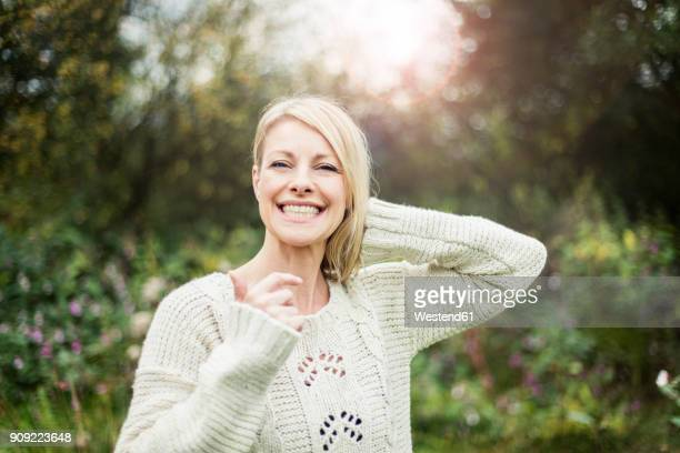 portrait of happy blond woman outdoors - 40 44 jahre stock-fotos und bilder