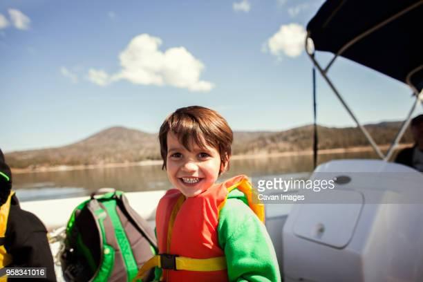 Portrait of happy boy standing on yacht