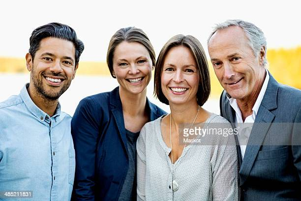 portrait of happy business people outdoors - small group of people stock pictures, royalty-free photos & images