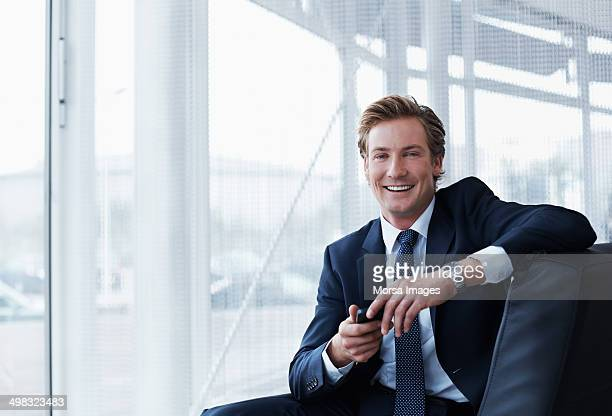 portrait of happy businessman in office - traje completo - fotografias e filmes do acervo