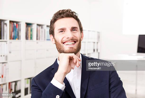 Portrait of happy businessman in the office
