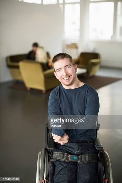 Portrait of happy businessman with cerebral palsy at office lobby