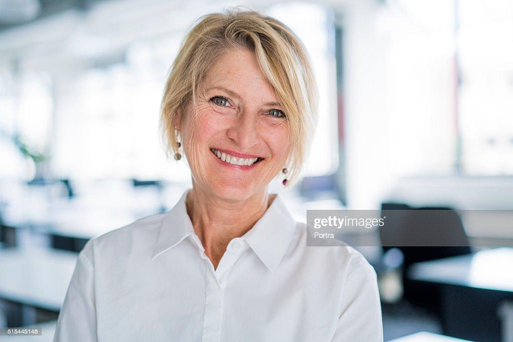Portrait of happy businesswoman in office : Stock Photo