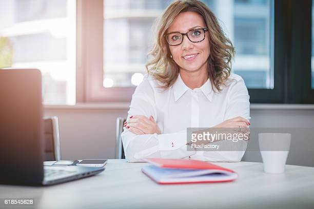 portrait of happy businesswoman smiling - big white women stock photos and pictures