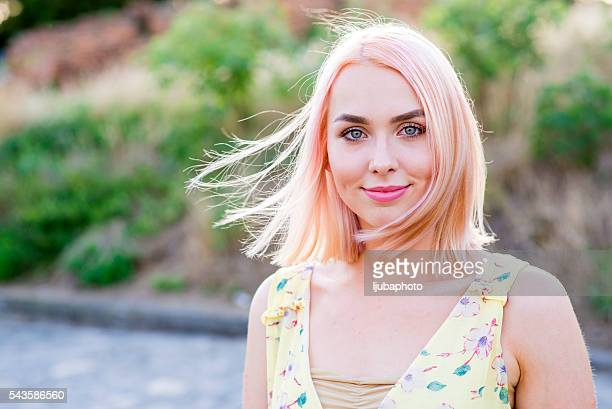 Portrait of happy cheerful smiling young beautiful blond woman,
