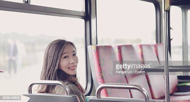 Portrait Of Happy Commuter Sitting In Bus