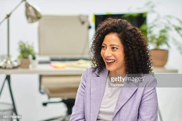 portrait of happy, confident mature businesswoman in office laughing - one mature woman only stock pictures, royalty-free photos & images