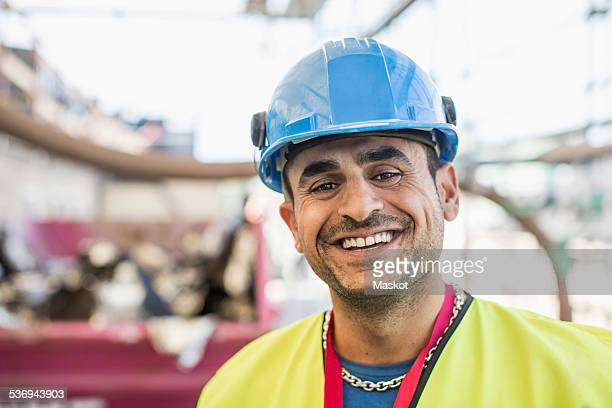 Portrait of happy construction worker at site