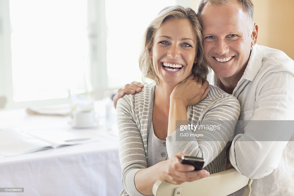 Portrait of happy couple at the breakfast table : Stock Photo