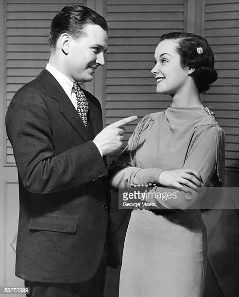 Portrait of happy couple conversing