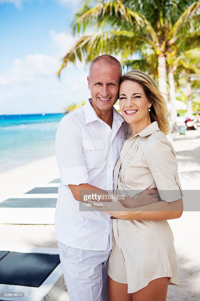 Portrait of happy couple embracing on beach : Stock Photo