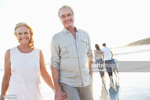Portrait of happy couple holding hands on a beach