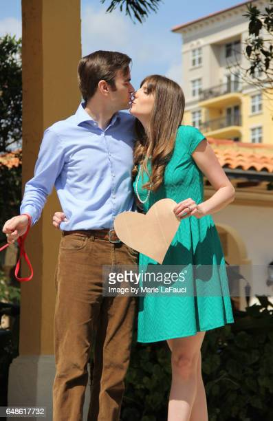 Portrait of happy couple kissing outdoors