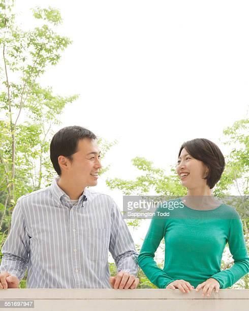 portrait of happy couple - 中年カップル ストックフォトと画像