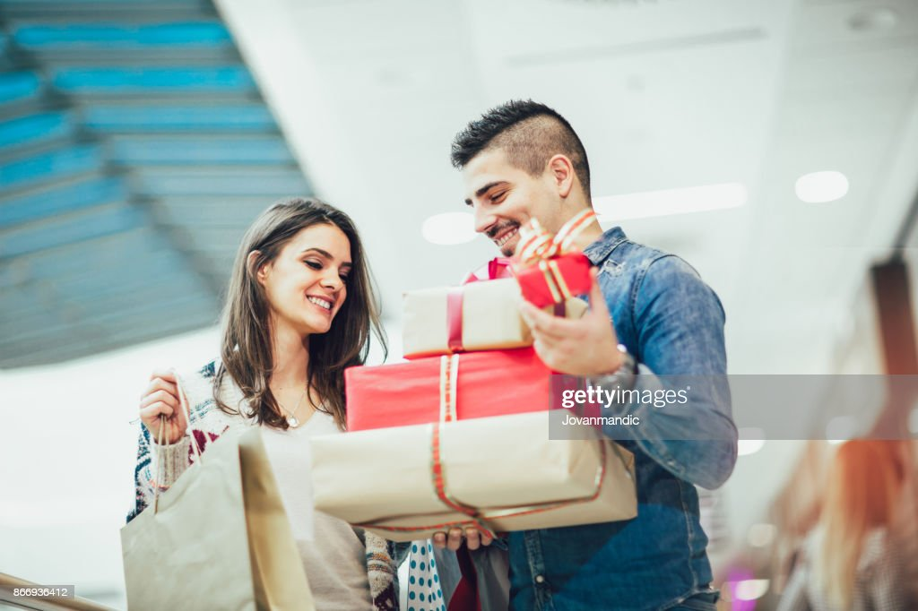 Portrait of happy couple with Christmas presents : Stock Photo