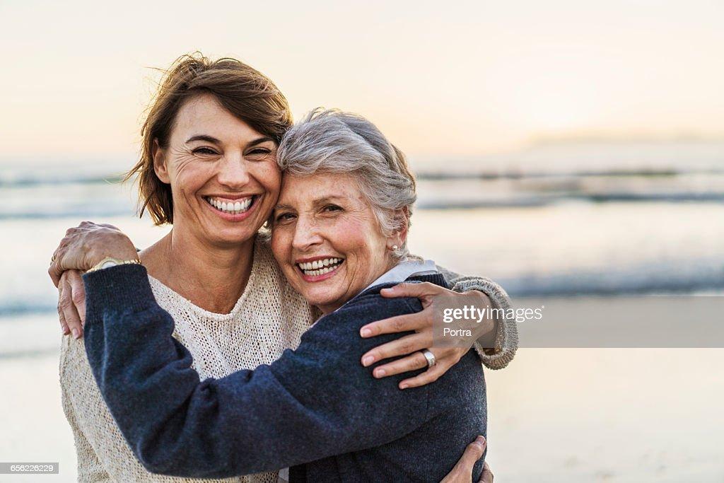Portrait of happy daughter embracing senior woman : Stock-Foto