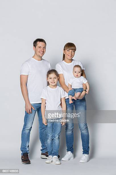 Portrait of happy family against white background