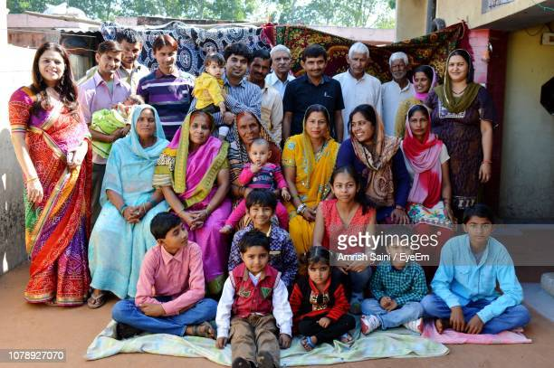 portrait of happy family in traditional clothing - village stock pictures, royalty-free photos & images