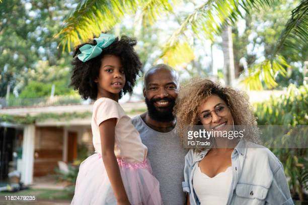 portrait of happy family looking at camera - big hair stock pictures, royalty-free photos & images