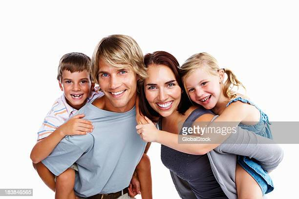 Portrait of happy family of four with kids on parents' backs