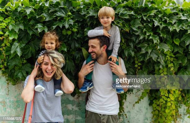 portrait of happy family outdoors - city life stock pictures, royalty-free photos & images