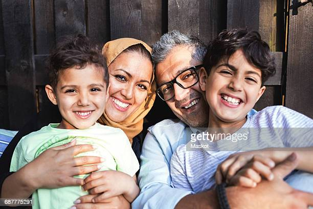 portrait of happy family outside house - islam fotografías e imágenes de stock