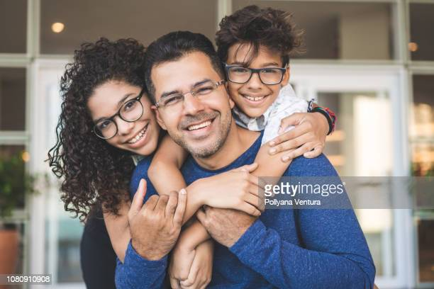 portrait of happy family - three people stock pictures, royalty-free photos & images