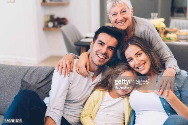 portrait of happy family - multi generation family stock pictures, royalty-free photos & images
