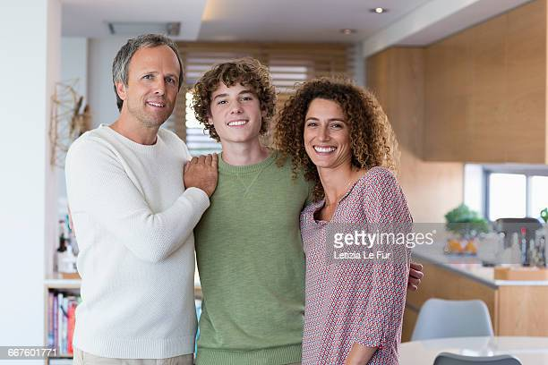Portrait of happy family smiling at home