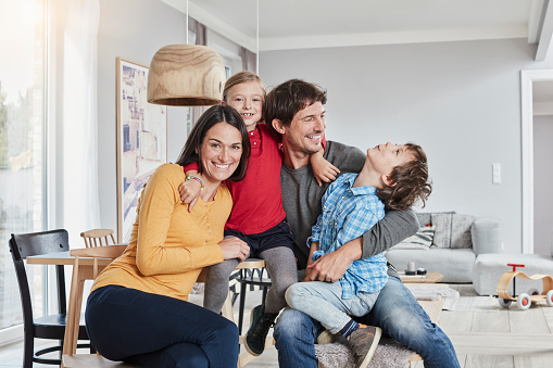 Portrait of happy family with two kids at home - gettyimageskorea
