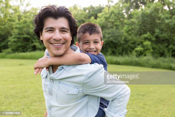 portrait of happy father and son - nephew stock pictures, royalty-free photos & images