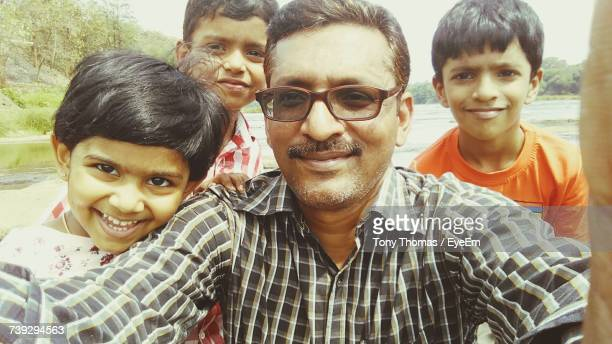 Portrait Of Happy Father With Children