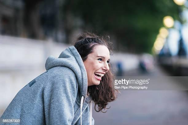 portrait of happy female runner taking a break on riverside - ロンドン サウスバンク ストックフォトと画像