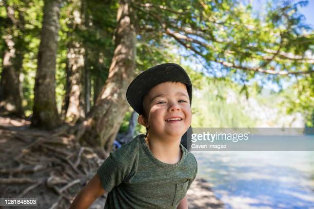 portrait of happy four year old boy at lindeman lake, chilliwack, b.c. - golden hour stock pictures, royalty-free photos & images