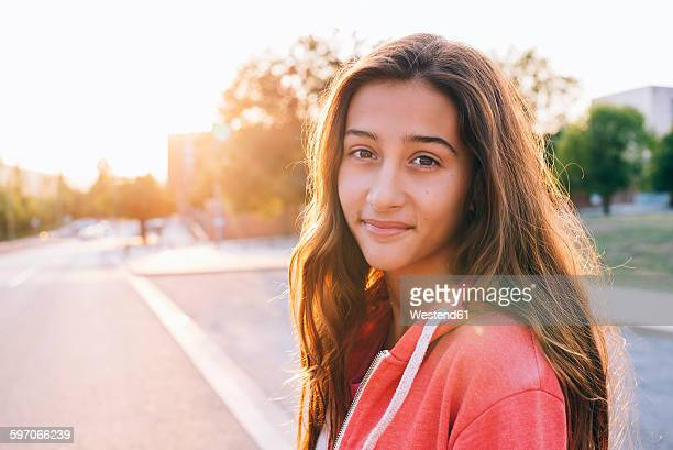 Portrait of happy girl at backlight