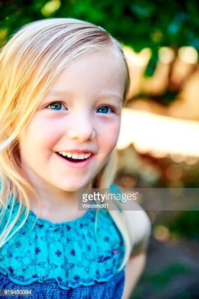 Portrait of happy girl outdoors