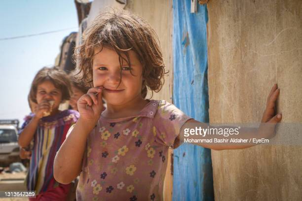 portrait of happy girl smiling - refugee stock pictures, royalty-free photos & images