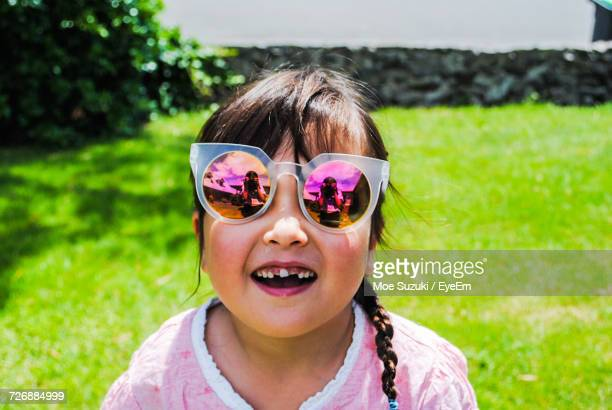 Portrait Of Happy Girl Wearing Sunglasses