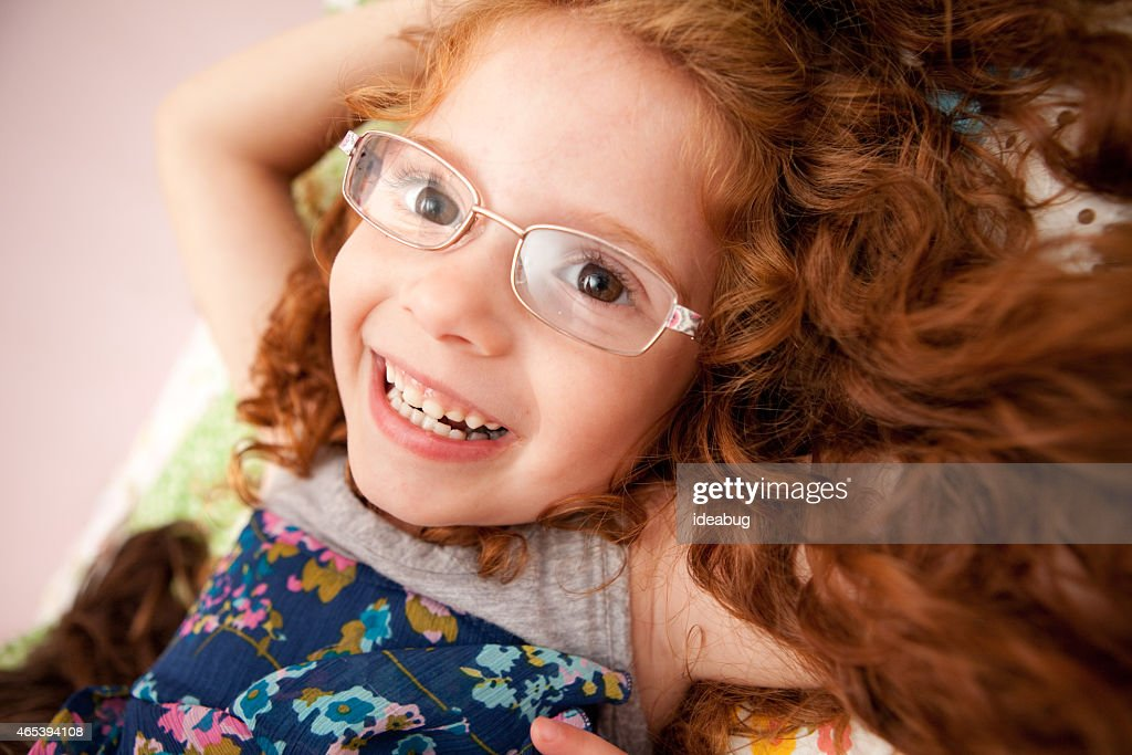 e36324a07 Portrait Of Happy Girl With Glasses And Curly Red Hair Stock Photo ...